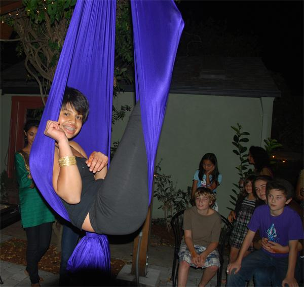 Junior Sama Rao swings from a silk. Photo Courtesy of Sama Rao.