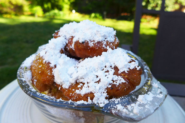 These fluffy New Orleans doughnuts are drizzled with honey and covered in powdered sugar