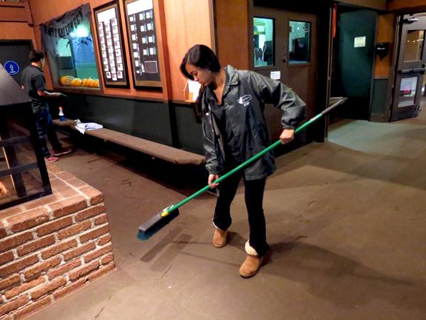 Junior Sabrina Goyal cleans up after the Winter Lodge closes to the public.