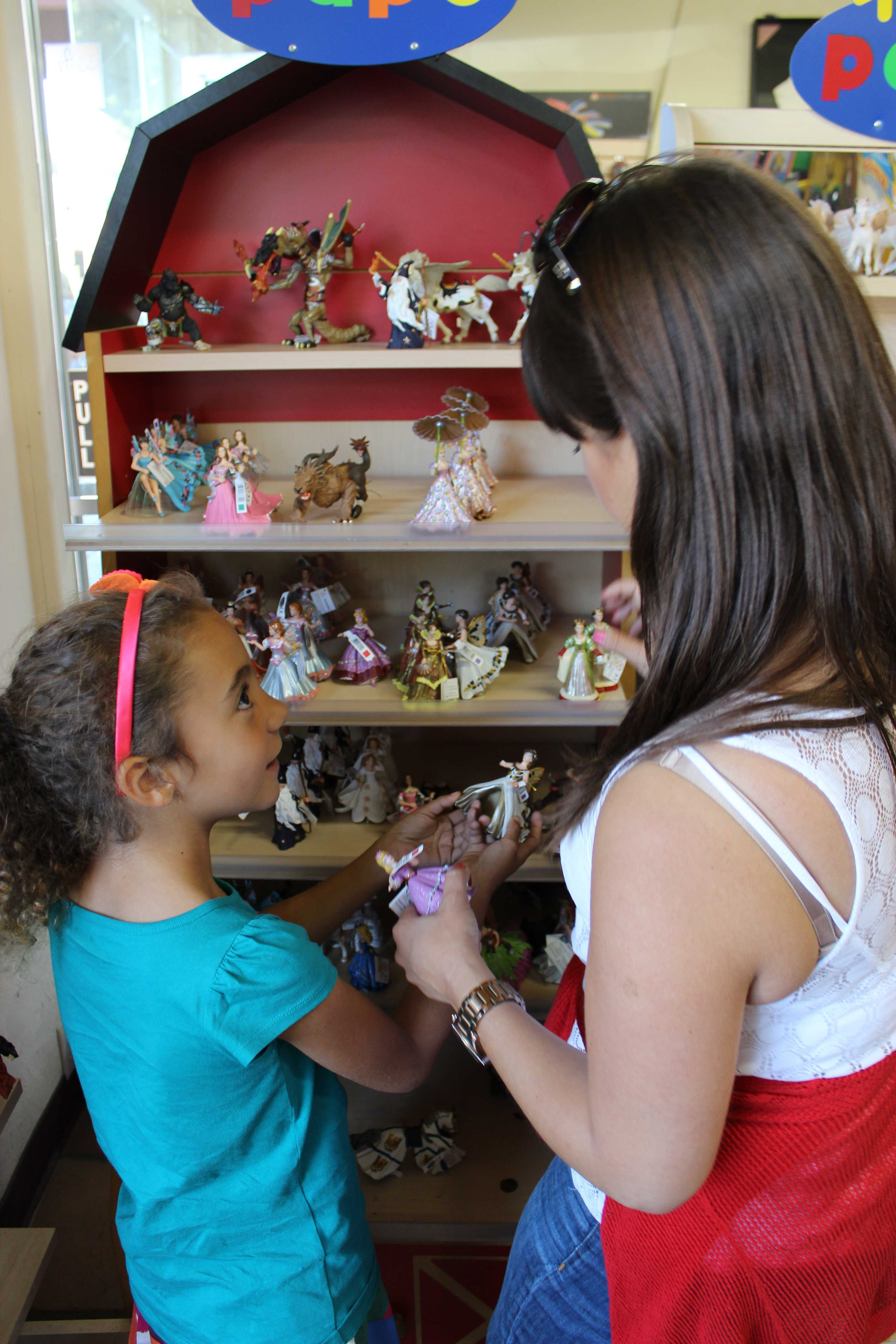 Palo Alto Sport Shop & Toy World customers explore the shop's display of animal figurines. Photo by Madison Mignola.