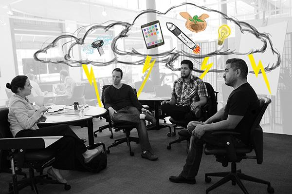 (Left to right) Institute for the Future employees Betina Walburg, Rod Falcon, Ben Hamamoto and Brad Kreit get creative in brainstorming ways to improve the future.