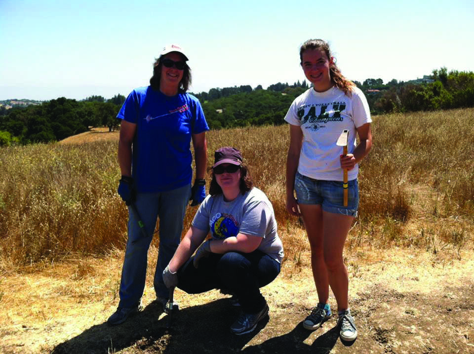The Team: Cayla Wanderman-Milne (right) poses with volunteers