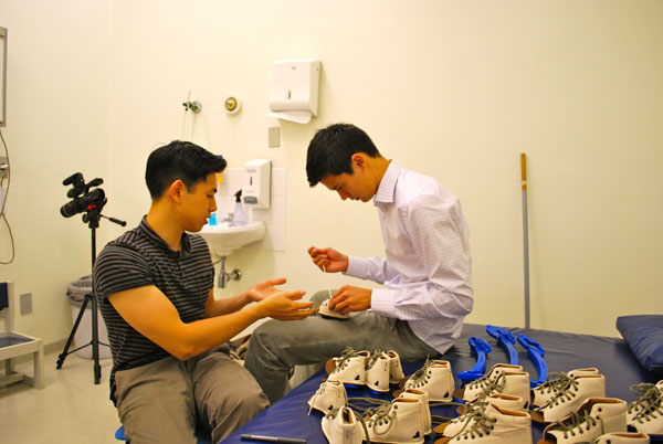 Miraclefeet brace co-founders Ian Connolly and Jeff Yang prepare for the product's initial user testing. The two hope this brace will become the affordable, readily available solution to children for children with clubfoot in developing countries.