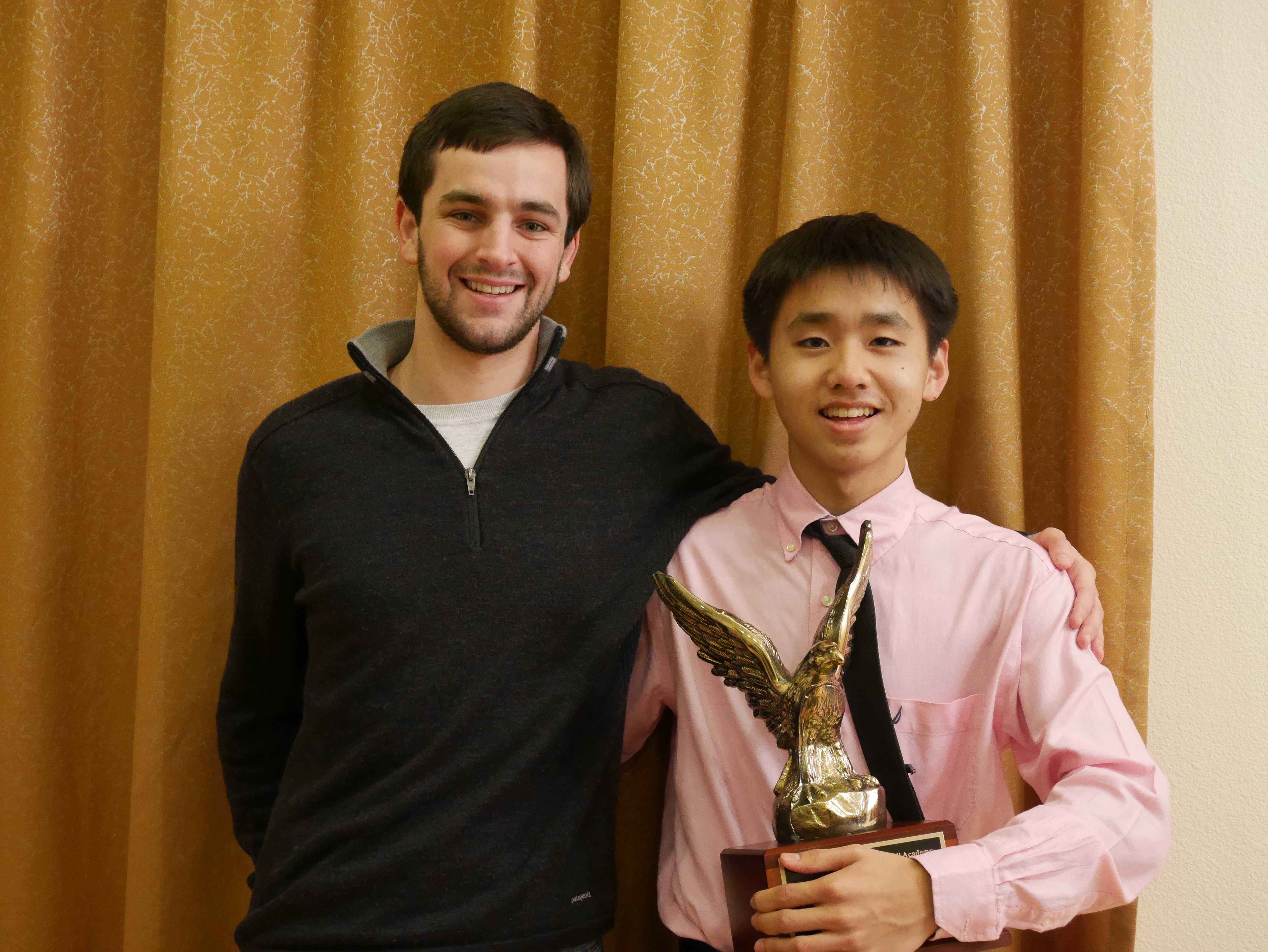 """Chen poses with coach and Paly alum Alex Carter after winning a tournament. """"""""The biggest thing with Travis is that he is very well-rounded as a debater,"""" says Carter.  """"He doesn't specialize in one type of argument over the other."""""""