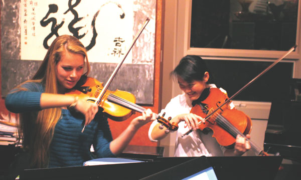 Palo Alto High School seniors Megan Rohrer (left) and Tessera Chin (right) rehearse at Chin's house.