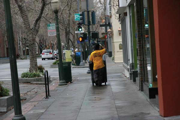 Efren Perez (top right) wheels garbage downtown. Rodriguez bungie-ties all his worldy possesions to the back of a bike.