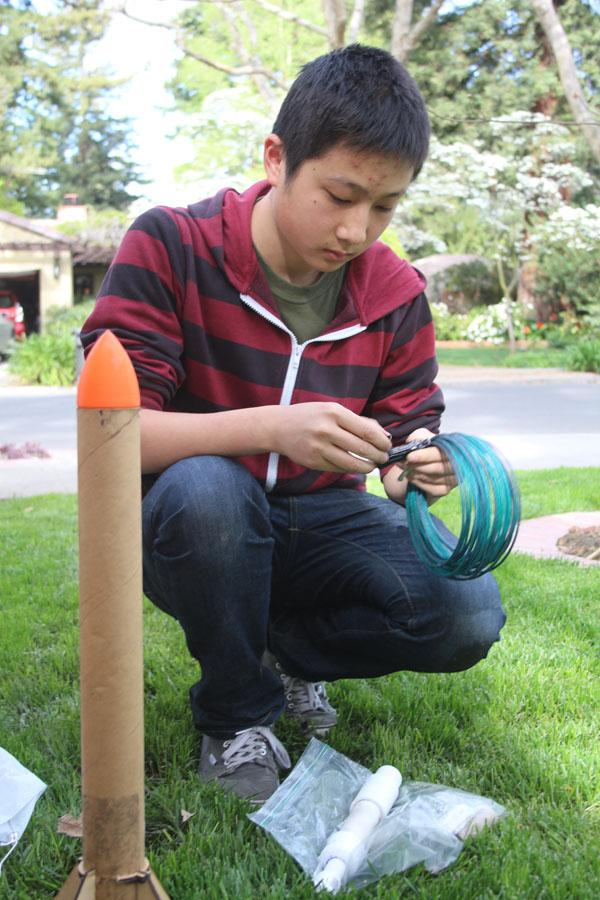 Sophomore James Wang prepares his rocket for its launch.