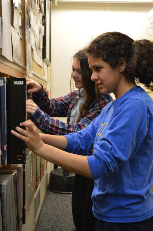 Sophomores Saba Moussavian and Clara Wolfe explore the vast vinyl collection at KZSU Radio station.