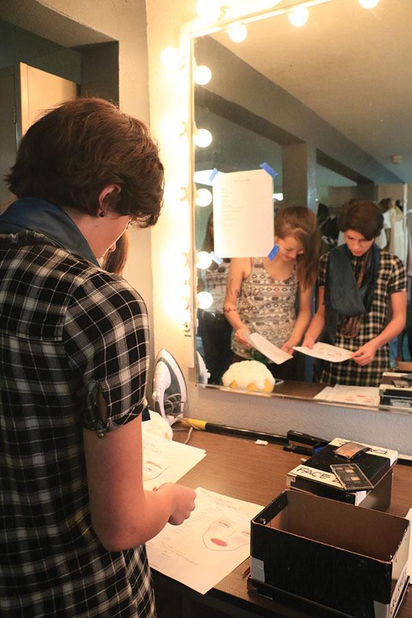 Junior Claire Kemmerer  reviews makeup designs for actors.