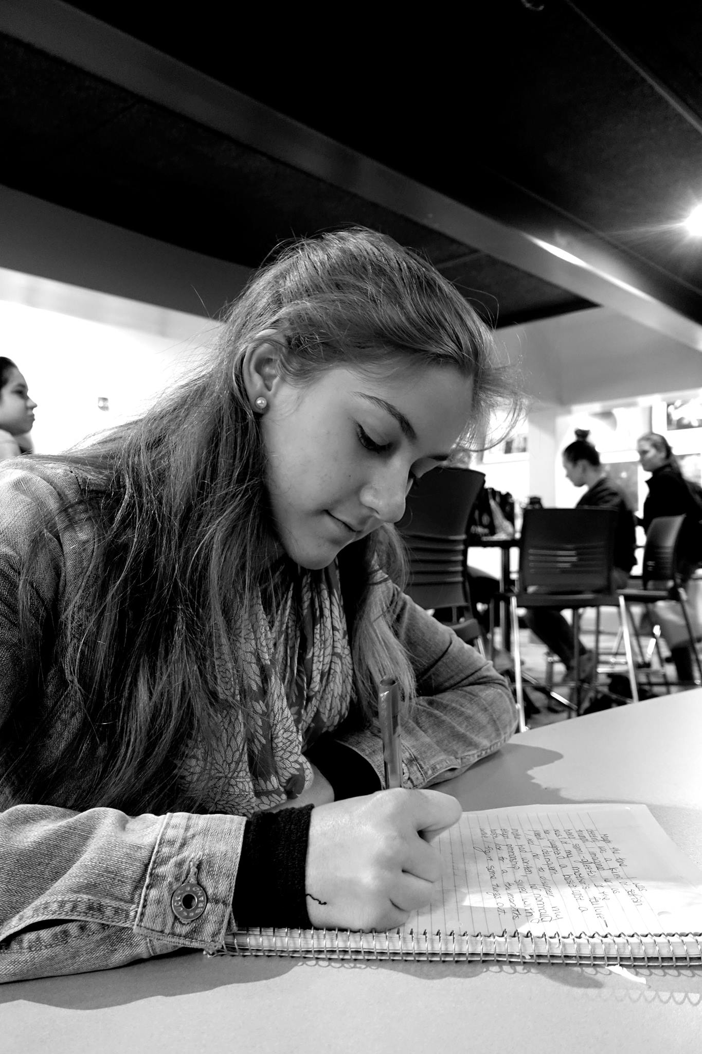 BRAINSTORM Senior Caroline Bailey jots down ideas for her science-fiction novel.