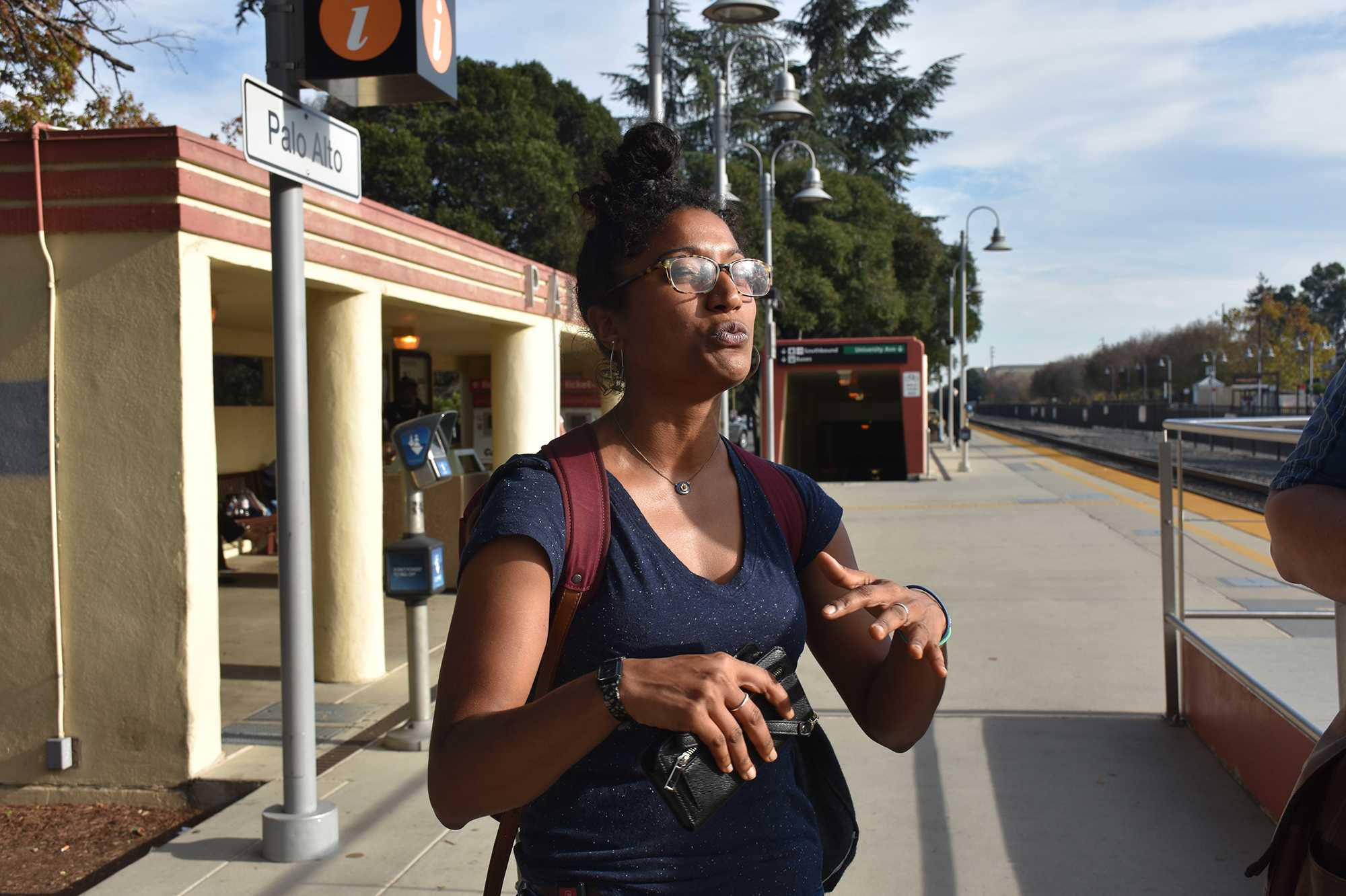 """Kahrson gestures enthusiastically as she declares her love for public transportation. """"I love eavesdropping on people's conversations on the train,"""" Kahrson says."""
